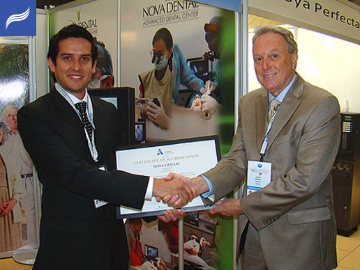 Dr.Luis Obando of Nova Dental and John Burke, Executive Vice-President and CEO of the AAAHC.